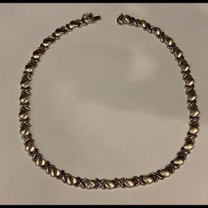 Woman's XOXO 14kt white gold necklace